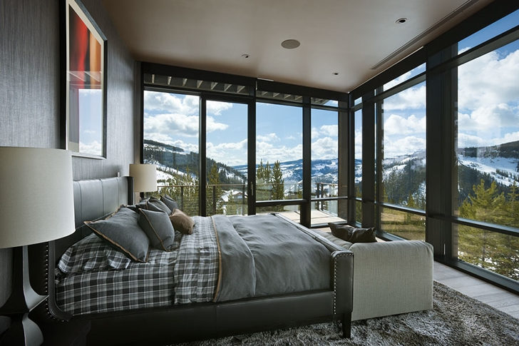 Glass wall bedroom in Elegant Mountain Home by Reid Smith Architects