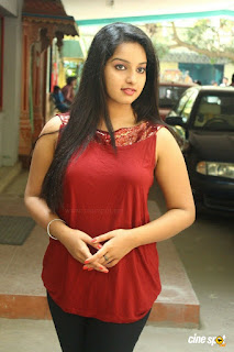 Malavika Menon in Spicy Red Sleeveless Top  and Black Leggings Latest Pics