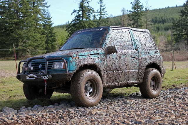 The Teal Terror in the mud at Mud Fest - Subcompact Culture