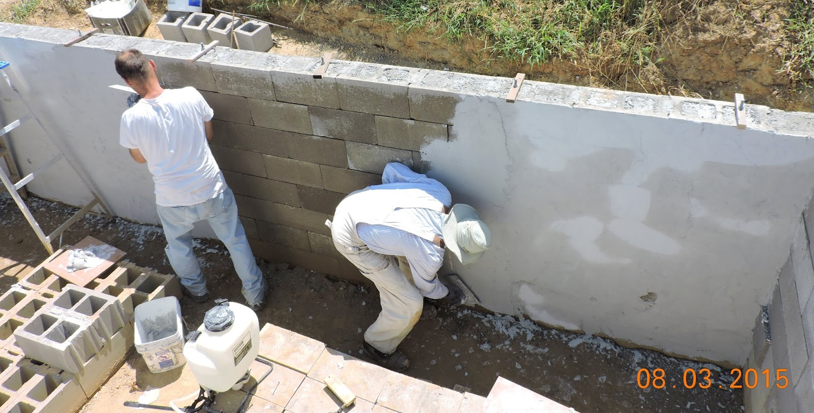 Do it yourself green building with jerry young 082515 parging the south wall with fiber bonded cement notice the anchor bolts for the 2 x 10 pressure treated boards that will cap the top of the wall solutioingenieria Images