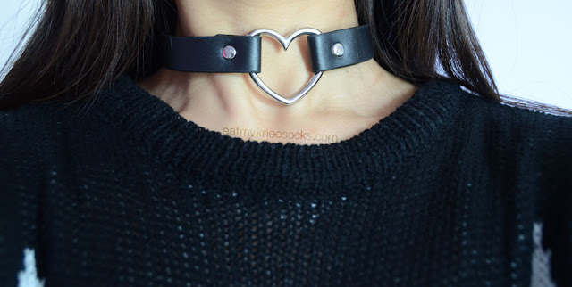 The Harajuku black leather heart ring choker, modeled with a black Wildfox dupe sweater.