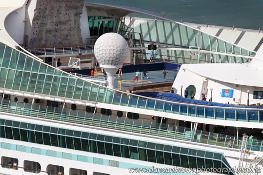 Footy for the boys, while Mums' out shopping, Voyager of the Seas cruise liner, berthed at Napier Port photograph