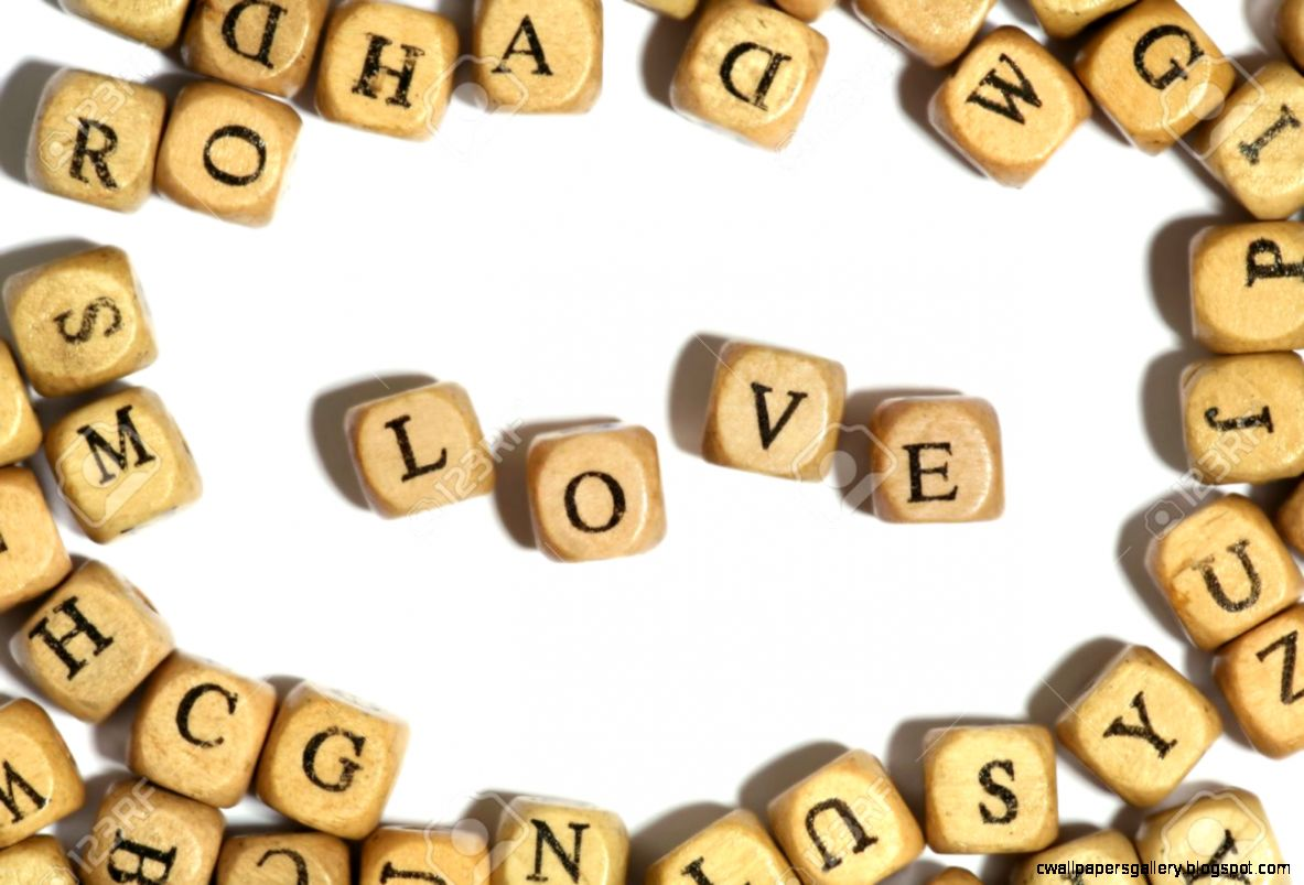 Block Letters Spelling The Word Love Over White Stock Photo