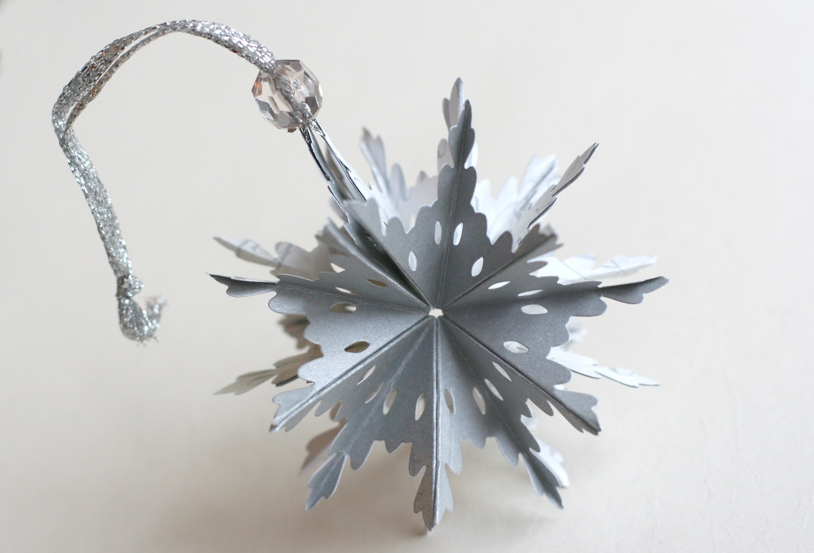 Make snowflake ornaments - This One Is A Snowflake Silver With Script On The
