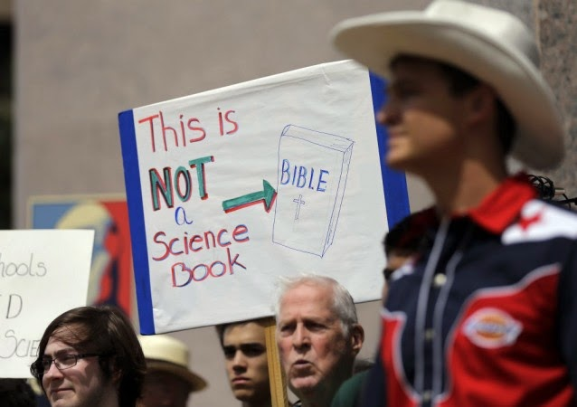 In this Sept. 17, 2013 file photo, pro-science supporters rally prior to a State Board of Education public hearing on proposed new science textbooks, in Austin, Texas.  (Credit: AP Photo/Eric Gay) Click to enlarge.