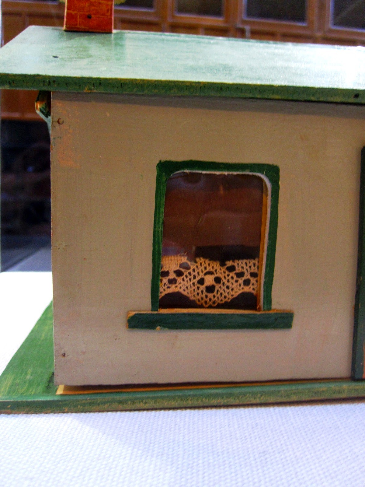 Side view of a vintage Walther & Stevenson miniature farm house building.