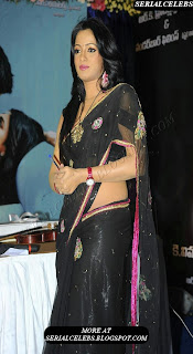 Udaya Bhanu in black low hip saree