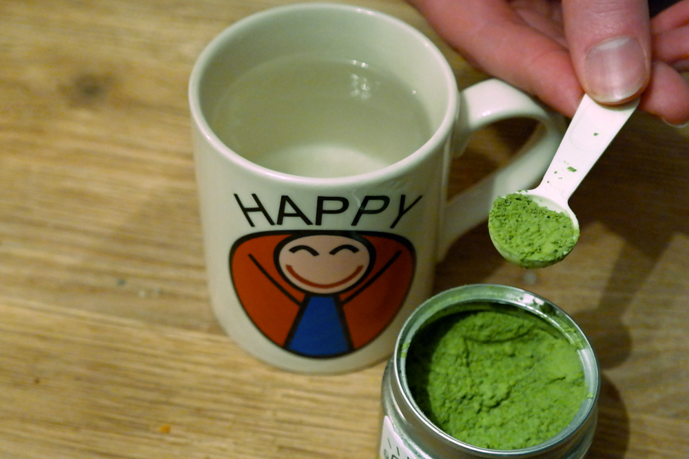 Mug of hot water, scoop of teapigs Matcha
