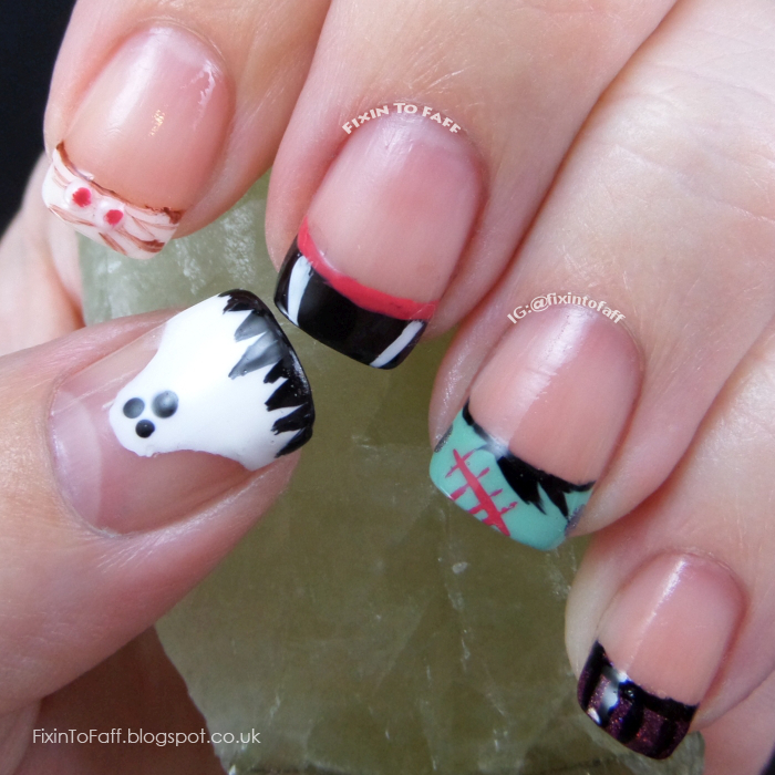Halloween nail art with various classic monsters portrayed as french tip designs.
