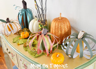 strips of scrapbook paper shaped into pumpkins