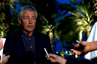 Chuck Hagel briefs the press in Abu Dhabi