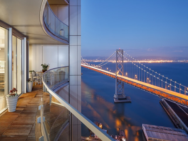 Picture of the bridge at sunset as seen from the balcony of small duplex apartment