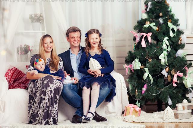 красивая семья на фотосессии студии