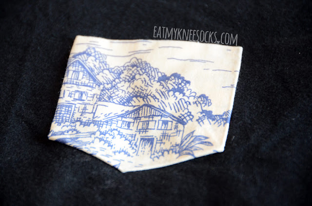 Close-up of the Japanese/Chinese landscape painting style pocket on the Japanese Village pocket tee from Tea Apparel.