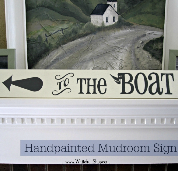 "Hand painted ""To The Boat"" sign with arrow leaning on mantle."