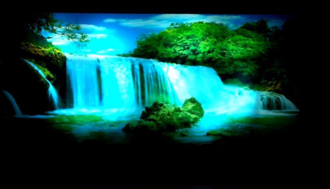 Moving Picture in MotionMirror Framed Waterfall Picture With