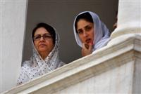 Former Indian cricketer Mansur Ali Khan Pataudi's wife, Sharmila Tagore, left, and Bollywood actor Kareena Kapoor attend his funeral in Pataudi.