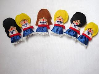 Broches aste nagusia muñecas de fieltro