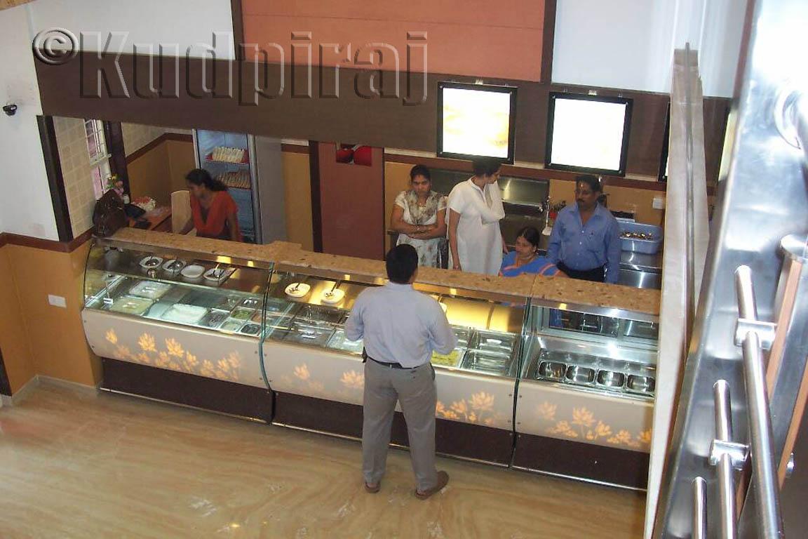 Kudpiraj's Garam Tawa: Ideal Café – A Restaurant Par Excellence #8D593E