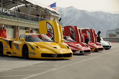 Yellow and Red Ferrari FXX's all lined up - one yellow and two reds