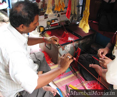 artisans making clasps dagina bazaar