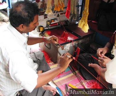 artisans making clasps dagina bazaar
