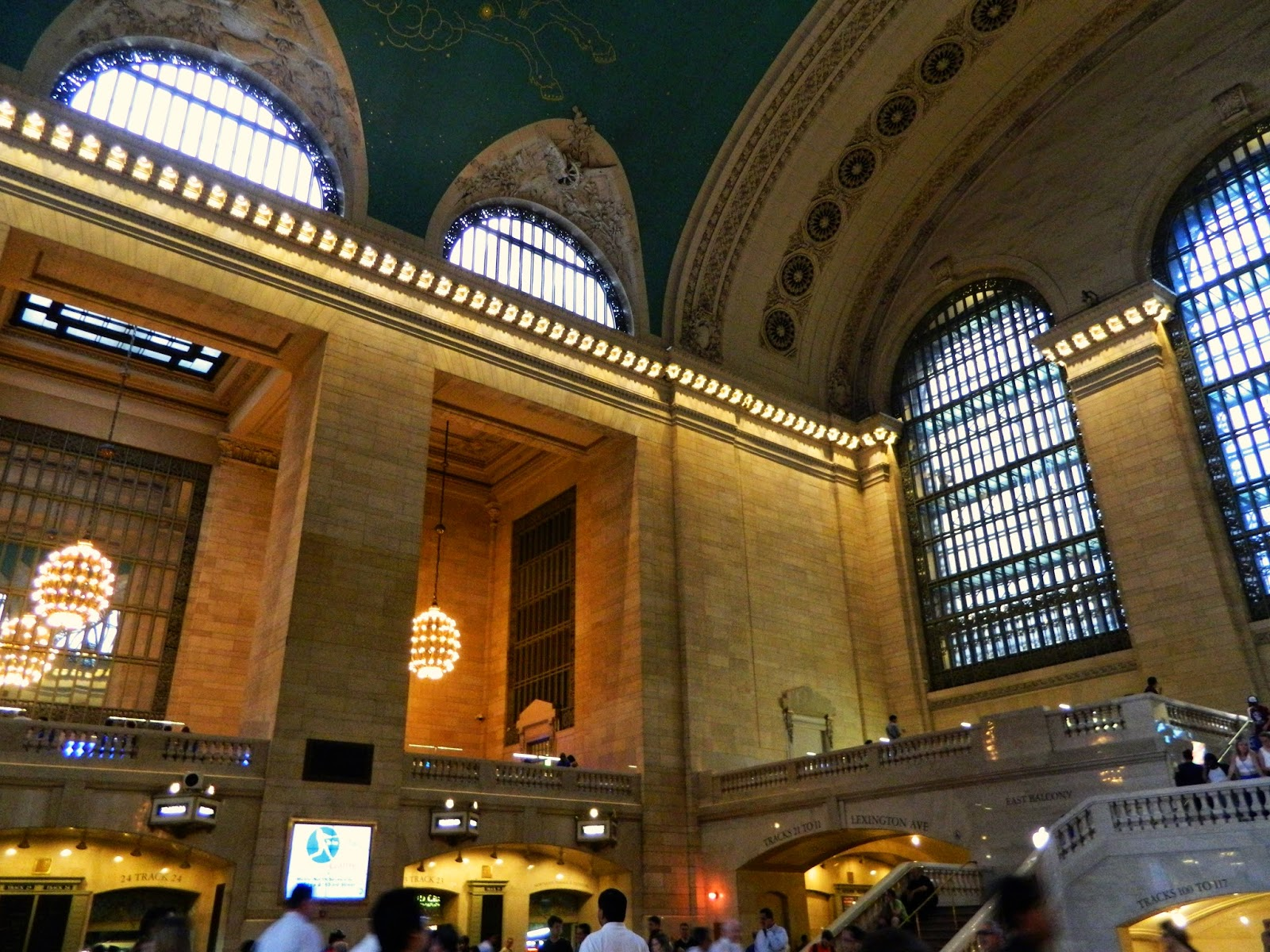 new york city grand central station inside people stairs windows architecture