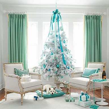 [A green and white interior with a white Christmas tree]