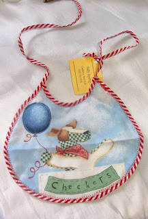 Shop for handmade baby shower gifts like this Checkers baby bib which is hand-sewn by Sally Spring and is available at handamdecatalog.com for only $3.00