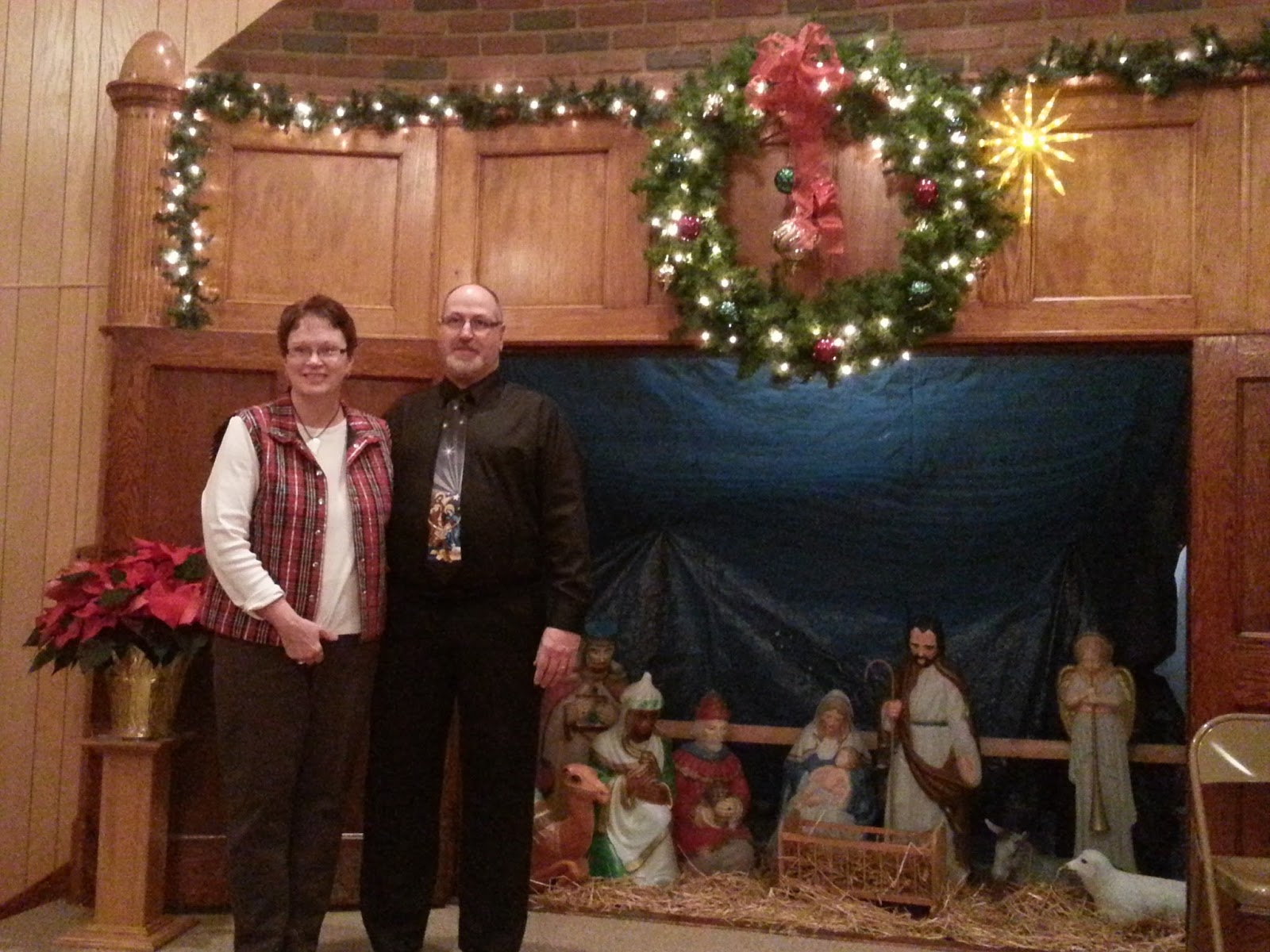 The cerro gordo church of the brethren christmas greetings pastor tim and betty sue posed beside the nativity set that was given to the church by paul and maxine garver several years ago kristyandbryce Image collections