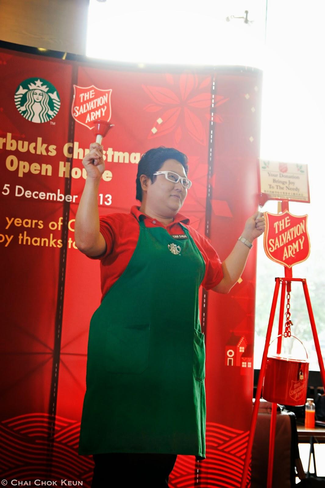 goh yan zhen store manager of starbucks plaza singapura ringing the bell to