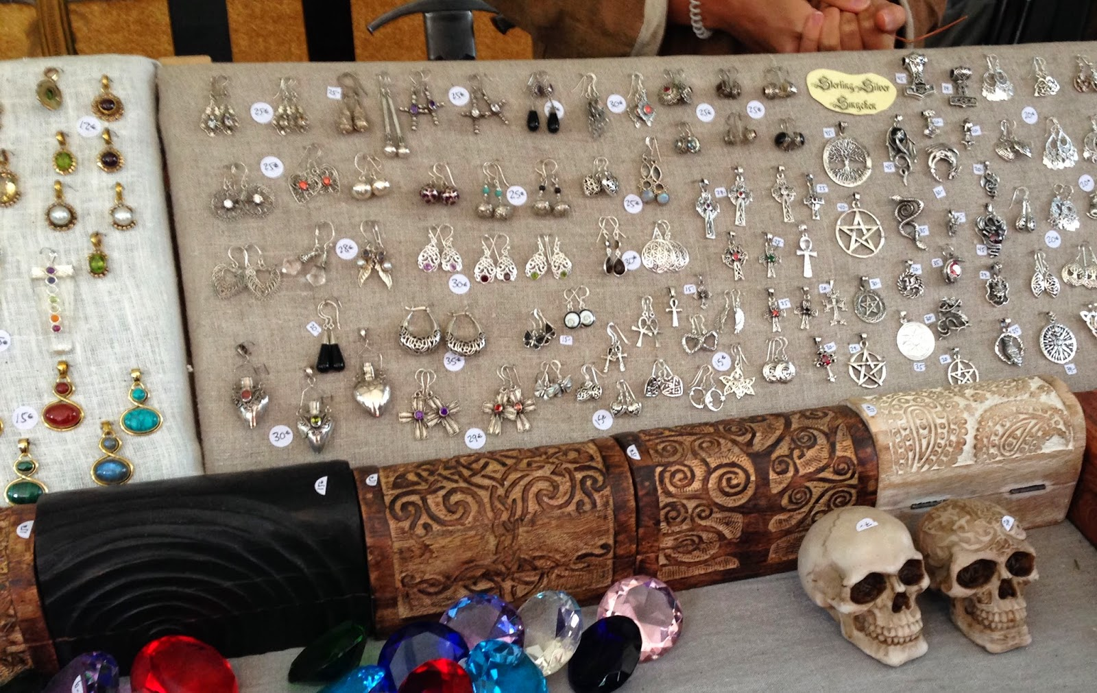 A picture of medieval jewellery, boxes, diamonds, skulls.