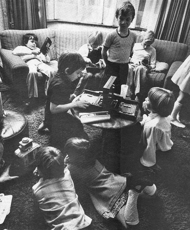 1979 December Personal Computer World photo. A group of young children playing with the latest electronic gadgets and toys.