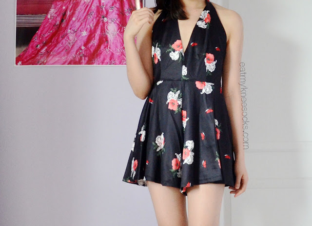For a fun, cute summer jumpsuit, try SheInside/SheIn's halter floral romper, a dupe of the Smooth Talker Romper by Free People.
