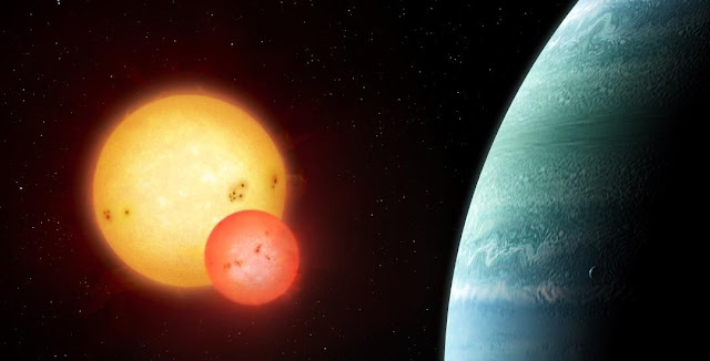 Artist's impression of the Kepler-453 system showing the newly discovered planet on the right and the eclipsing binary stars on the left. Illustration copyright Mark Garlick, markgarlick.com
