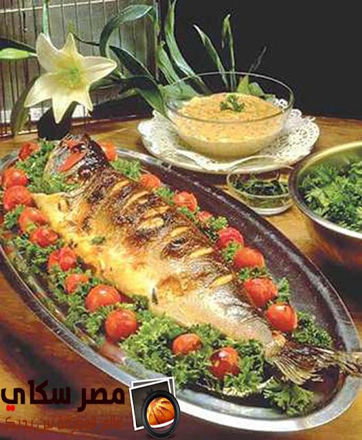 خطوات عمل صينية السمك القاروص بالبقدونس
