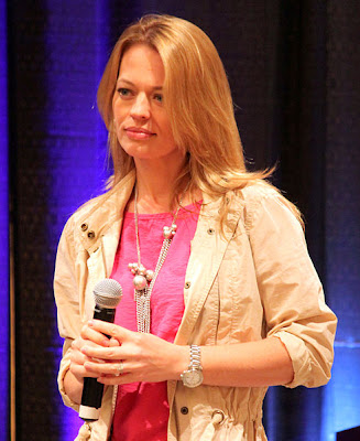 Voyager star Jeri Ryan, microphone in hand, at the Creation Star Trek Convention at the Hilton Hotel in Parsippany, New Jersey, 2010