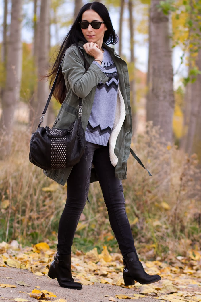 Fashion Blogger Withorwithoutshoes in a casual comfy outfit with jeans and parka