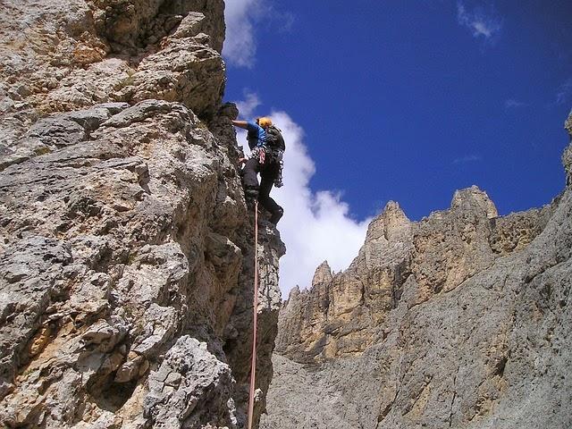 man climbing biggest mountain