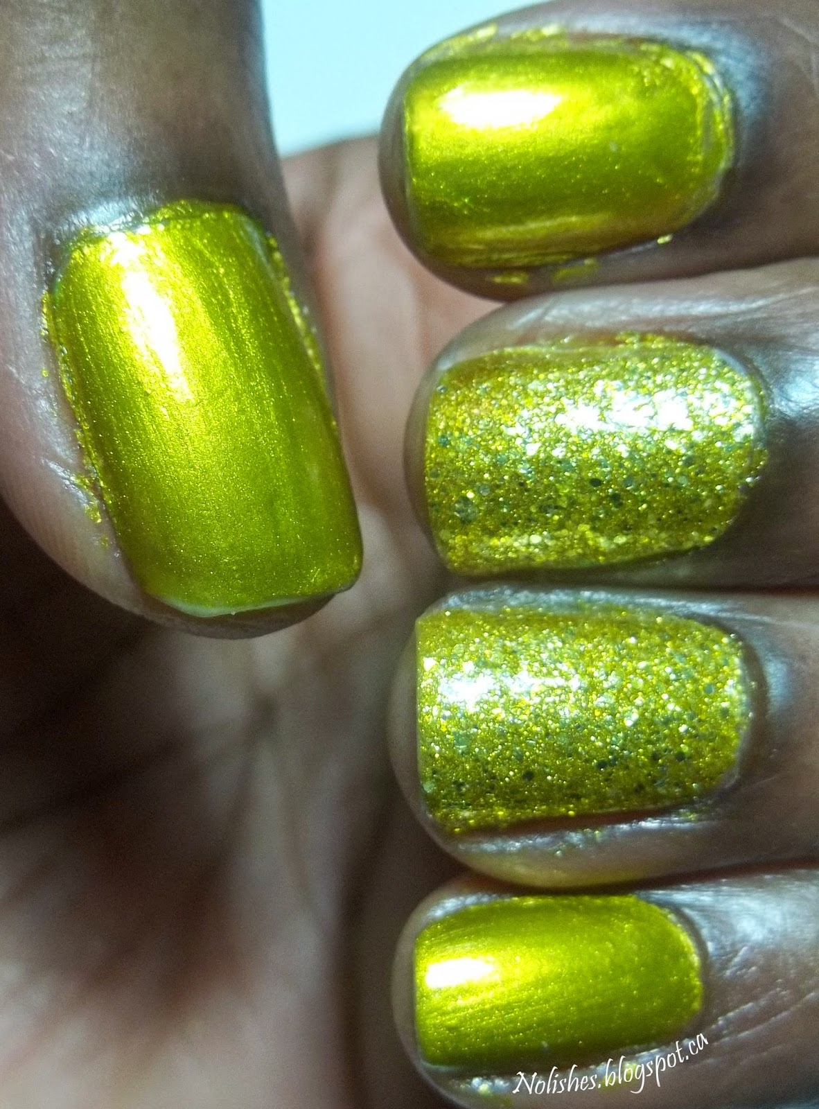 A manicure featuring chartreuse nail polish in 2 different ways. The thumb, index, and pinky are covered in a metallic chartreuse polish, while the ring finger and middle finger feature a chartreuse glitter polish.