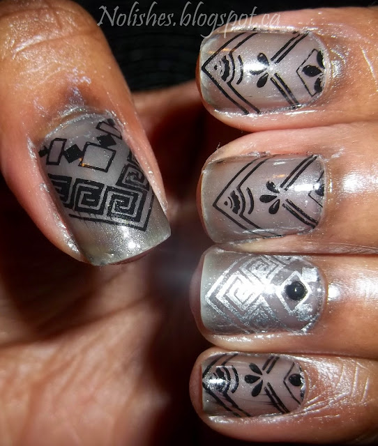 Nail Stamping manicure with a sheer black base, stamped with a variety of chevron designs in black and silver nail polish.