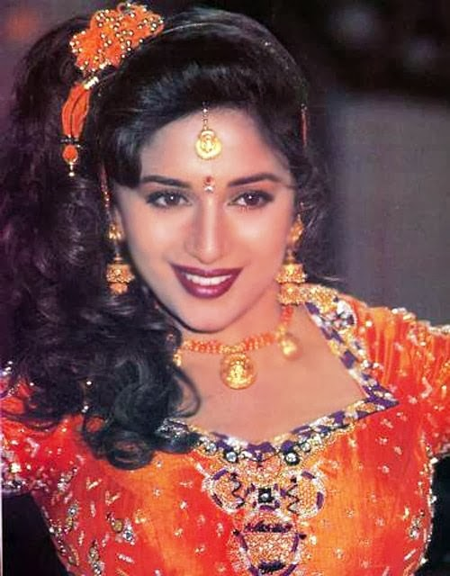 Madhuri Dixit in orange blouse and black and white bra