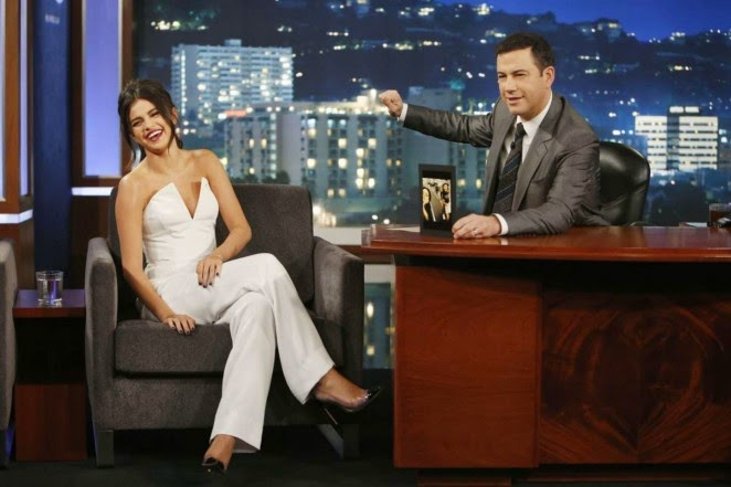 Selena Gomez flaunts a low-cut jumpsuit on Jimmy Kimmel Live in Hollywood