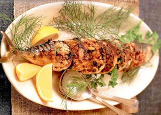 Mackerel stuffed with nuts and spices that's baked or fried to cook.