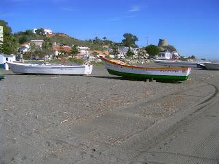 boats on beach in Benajarafe Spain