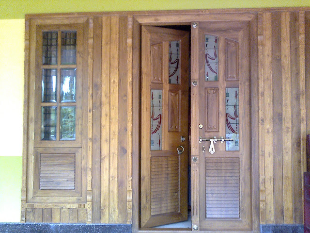 Kerala interior design decorations and wood works front for Wall in front of main door