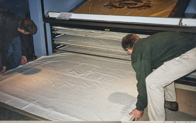 reduction of handling of artifacts, art conservator, conservation of flags and historic textiles.