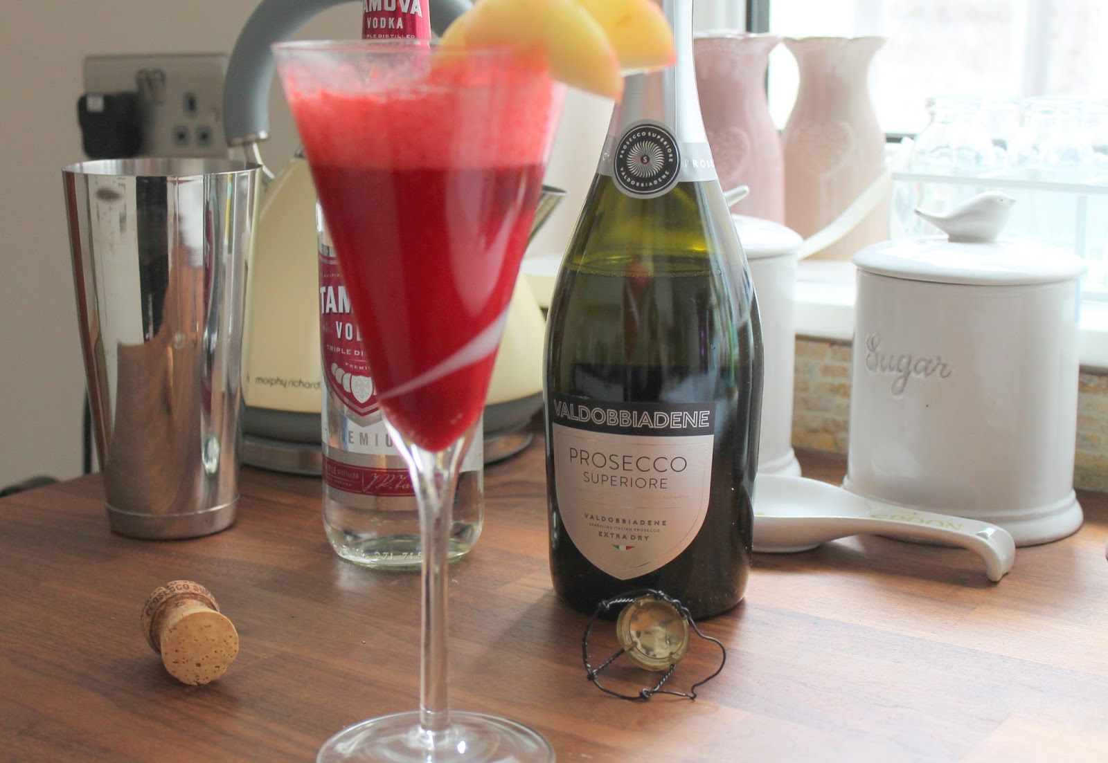 Aldi shooting star raspberry cocktail garnished with apple champagne cork