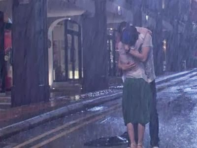 Ảnh hôn nhau dưới mưa - hình 1