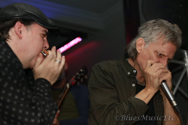 duelling harmonicas